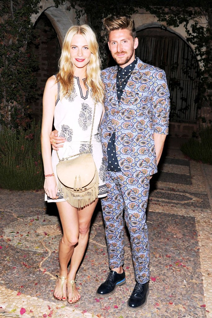 Poppy Delevingne slipped into Summer by way of an embellished frock, flat sandals, and fringed crossbody bag. Meanwhile, Henry Holland got playful in a printed suit. Source: Billy Farrell/BFAnyc.com