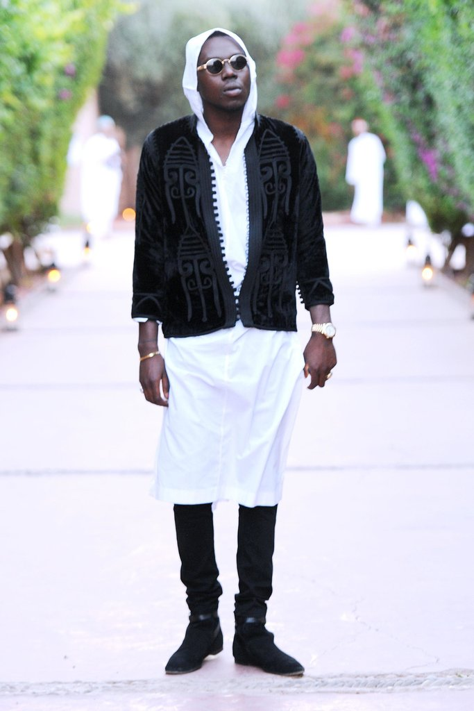 Theophilus London played with layers by wearing a knee-length white gown over black trousers and topping it all off with a black velvet jacket. Source: Billy Farrell/BFAnyc.com