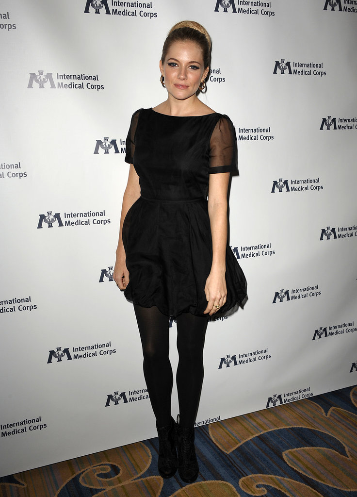 For the 2011 International Medical Corps Awards, the blond beauty stepped out in a black Twenty8Twelve dress — complete with sheer short sleeves — and black tights. Her small hoop earrings and slicked-back updo provided a slightly retro feel to the finished look.