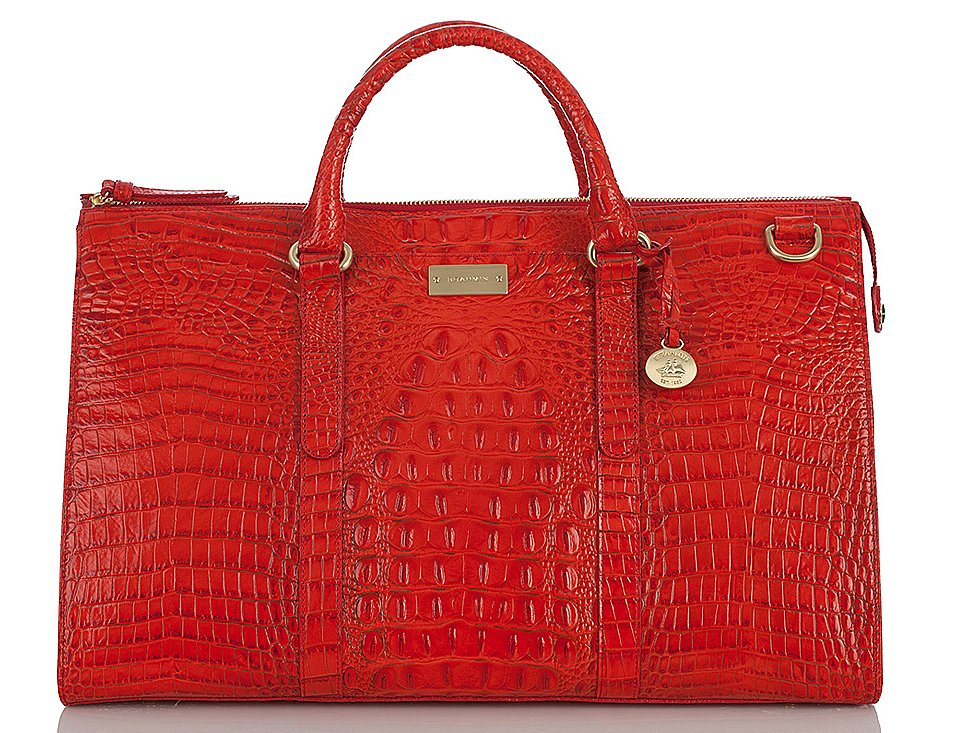 For something posh, go with this Brahmin red weekender bag ($395). Between the bold hue, the structured shape, and the croc-embossed detail, it's a must-have.