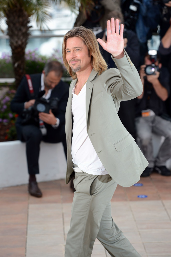 Brad Pitt waved to photographers during a photocall for Killing Them Softly at the Cannes Film Festival in 2012.