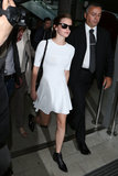Emma Watson arrived in Nice wearing a white dress and black boots.