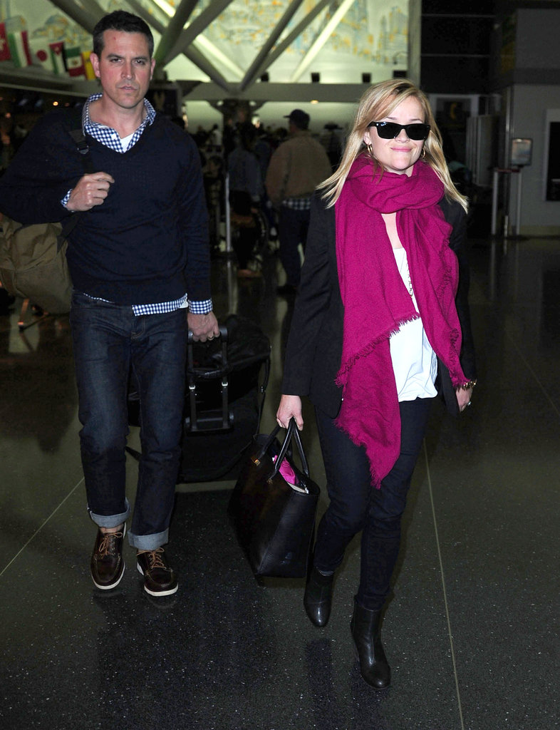 Reese Witherspoon landed at JFK with husband Jim Toth.