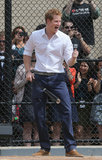 Prince Harry played baseball with the Harlem RBI baseball youth team in NYC on Tuesday.