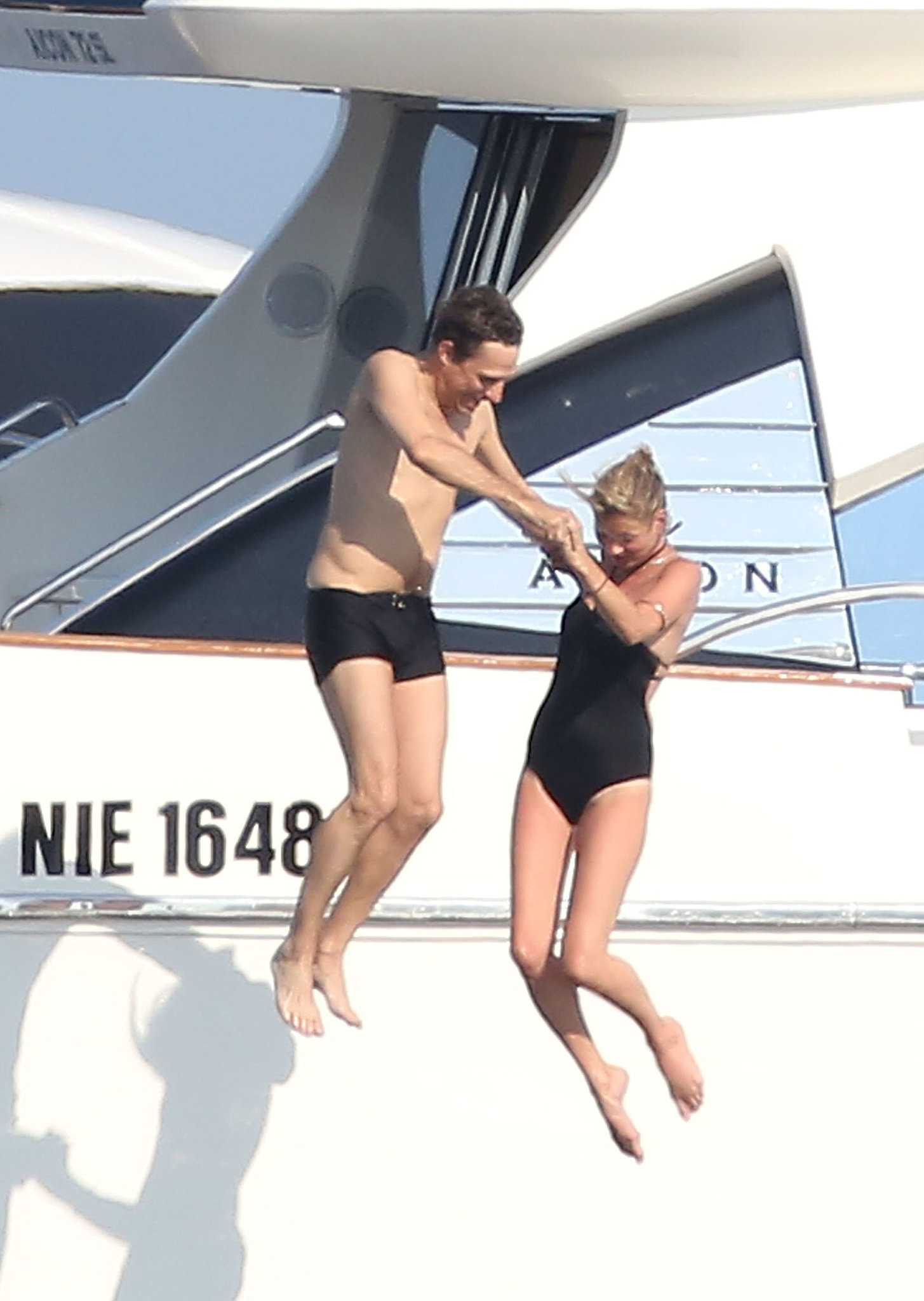 Kate Moss and Jamie Hince jumped off a yacht together during a St. Tropez vacation in July 2012.