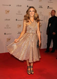 The blonde beauty shimmered in a golden one-shoulder Halston, strappy bronze sandals, and glistening clutch at the 2010 Bambi Awards.