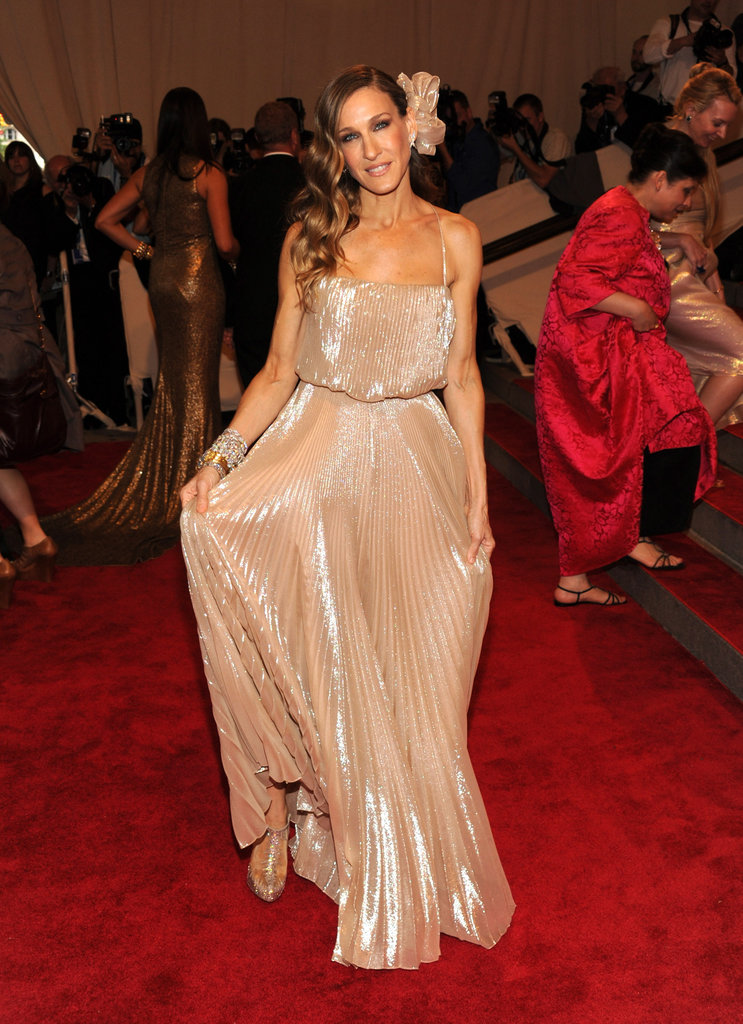 Parker posed in a pleated metallic Halston creation, coordinating bow headpiece, and stacked diamond bangles at the 2010 Met Gala in NYC.