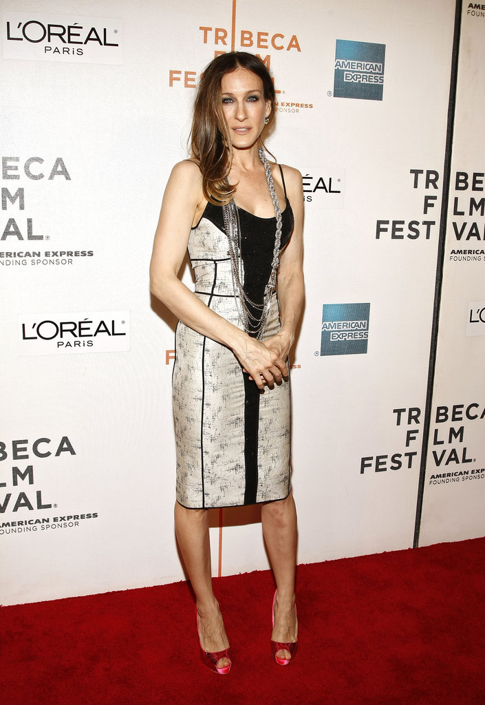 At the 8th Annual Tribeca Film Festival, the actress jazzed up her paneled body-con dress with a few statement-making accessories — a multichain necklace, diamond drop earrings, and hot-pink textured pumps.