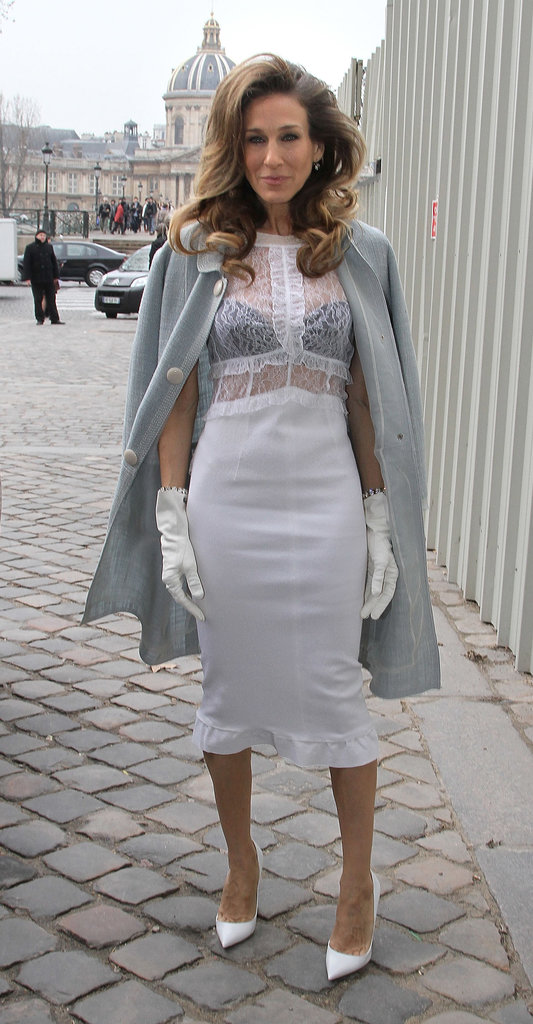 SJP channeled her inner seductress layering a white lace-bodice Louis Vuitton creation, complete with matching gloves and pointed pumps, over a black bra during Paris Fashion Week in March 2012.