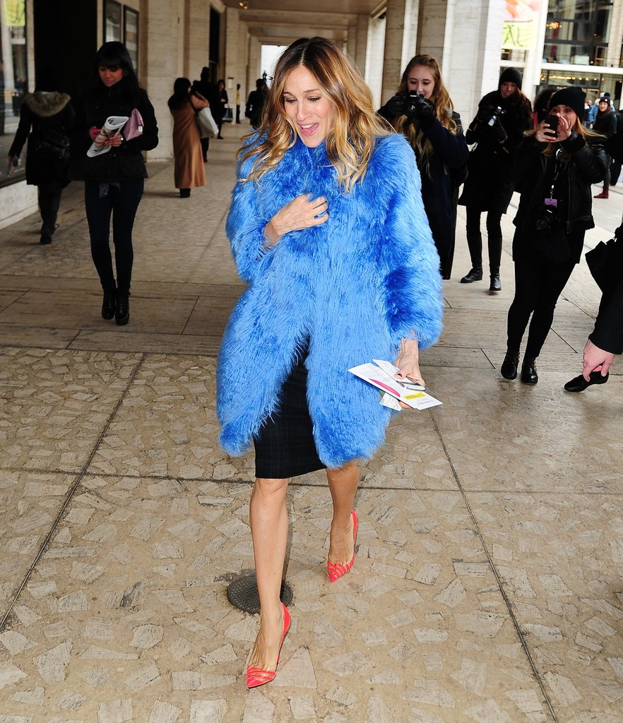 SJP layered a plush Misha Nonoo alpaca coat over a body-hugging L'Agence sheath, then completed her look with a pair of punchy Christian Louboutin pumps in NYC.