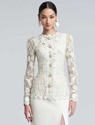 You can throw a lace jacket on over any dress for more coverage. This Oscar de la Renta ($3,890) floral embroidered piece has a modest round neckline, ultra luxurious cabochon-encrusted buttons and a sleek, modern fit.