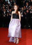 Julianne Moore showed off her strappy sandals in a Dior Haute Couture gown with an asymmetric hemline.