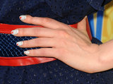 At a special screening of New Girl, Zooey rocked a striped manicure with a small heart accent on each nail.