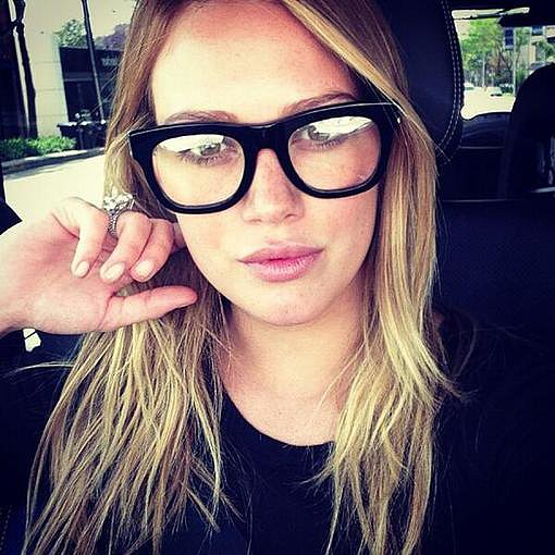 "Hilary Duff had a ""nerdy kind of day"" while wearing a pair of thick-frame glasses. Source: Twitter user HilaryDuff"