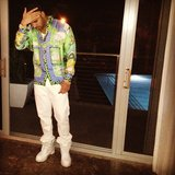 Drake showed off a summery look, mixing a printed silk top with white jeans. Source: Instagram user champagnepapi
