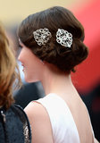 Katie Chang's hair was styled in a vintage coiffure, which she accented with ornate hair clips, adding to the classic flair.