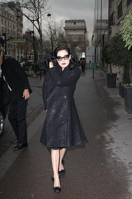 Winter wardrobe investment number one: a classic black dress coat. Just ask Dita Von Teese.