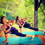 Gisele Bündchen posted a photo of herself doing yoga with a friend. Source: Instagram user giseleofficial