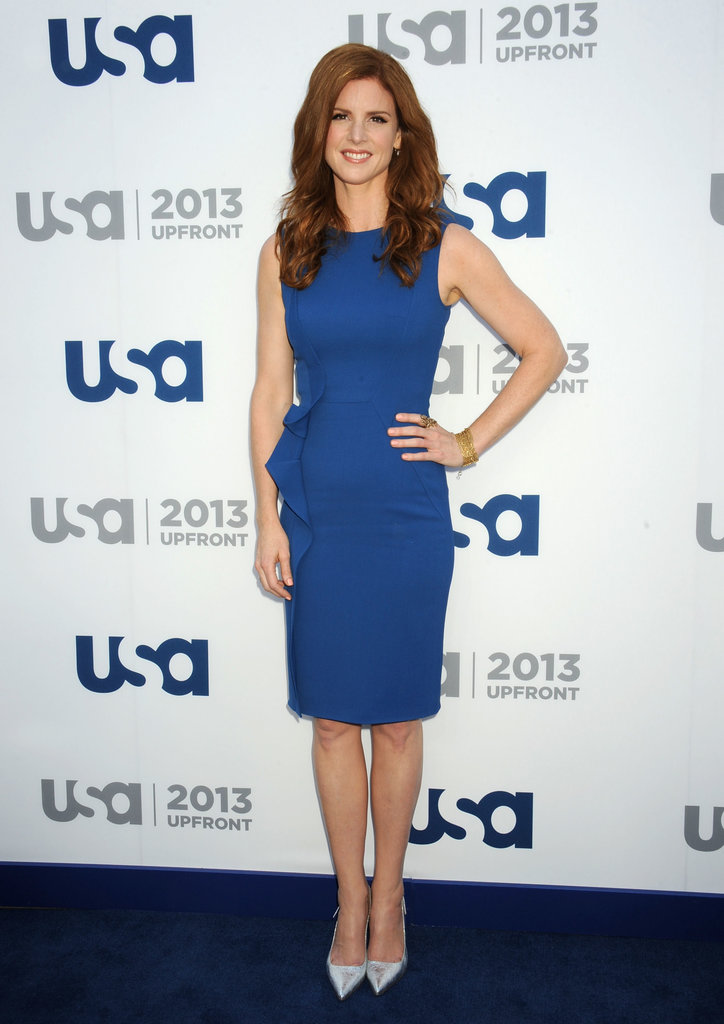 Suits star Sarah Rafferty wore a blue dress.