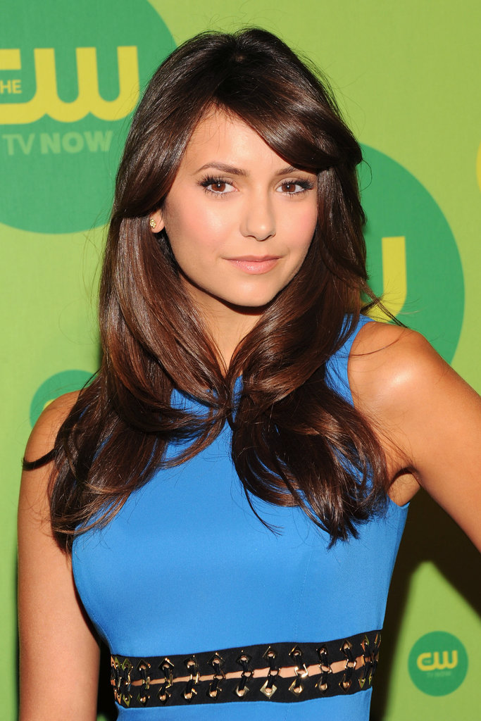 Nina Dobrev was out in New York for the CW network's upfront presentation with a glossy blowout. A natural makeup palette of warm taupe on the eyes, as well as peach on the lips and cheeks, completed her style.