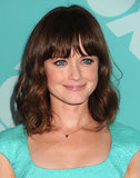 At a party for Fox, Alexis Bledel went with a flattering daytime look that consisted of volumizing mascara, peach blush, and a touch of gloss on her lips.