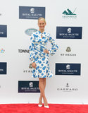 Karolina Kurkova nailed feminine Summer dressing with this blue and white floral Carolina Herrera sheath dress at the Sentebale Polo Cup.