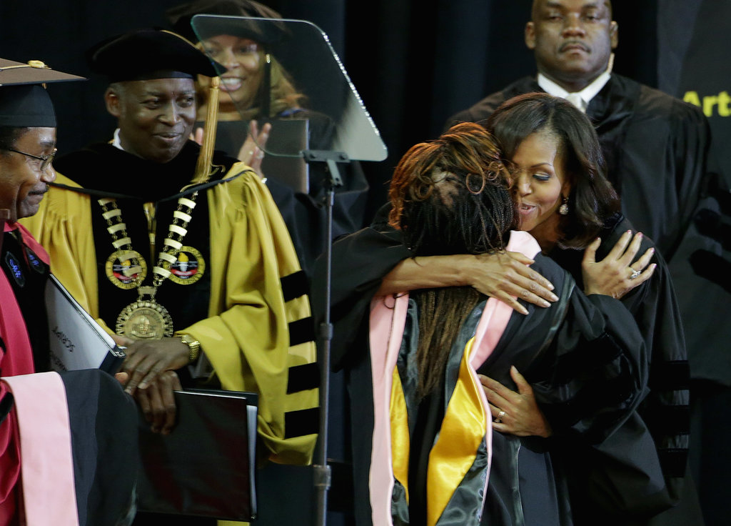 Michelle Obama hugged a graduate at Bowie State University.