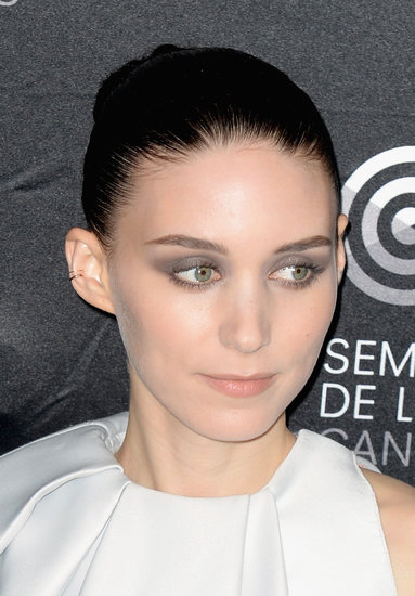 Rooney Mara wore an array of gray eye shadows and her hair slicked back into a tight bun at the Ain't Them Bodies Saints photocall.