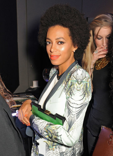 Solange Knowles popped in to the Belvedere party at Cannes wearing  matching orange lips and nails.