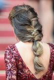 Cheryl Cole's hair was styled in a loose braid that harkened back to medieval times, creating an ideal hairstyle for more casual brides.