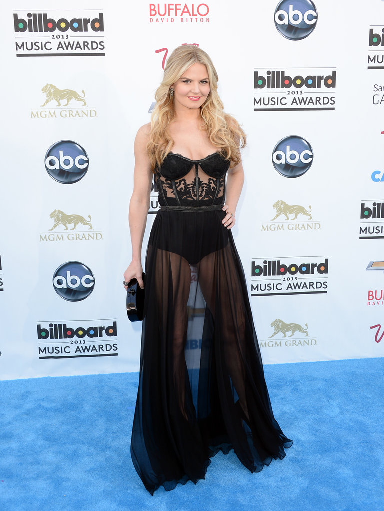 Jennifer Morrison turned heads in a very sexy jumpsuit. Between the corseted bodice and sheer skirt legs, there are quite a few skin-revealing elements to take in.