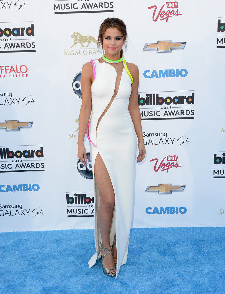 Selena Gomez chose a neon-infused Atelier Versace Spring '13 gown, complete with a sexy thigh-high slit. To finish, she wore silver metallic sandals and a high ponytail.