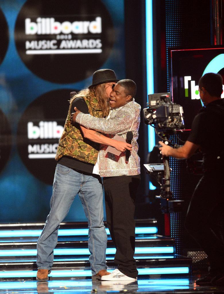 Kid Rock hugged Tracy Morgan onstage.