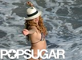 Songstress Paulina Rubio showed off her growing bump in in Malaga, Spain.