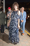 Milla Jovovich arrived in a breezy printed Chanel gown and Swarovski jewelry for the Vanity Fair and Chanel dinner.