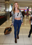 "The art of wearing a crop top at the airport, as illustrated by Georgia May Jagger: stay covered up on the bottom, as she did with classic jeans and boots. Like Georgia, you want your look to say ""'90s cool girl,"" not ""working girl."" An added layer like a button-down or anorak offers a little insurance against the AC — and against any unwanted attention. The bonus: customs can plainly see you're not hiding any liquids or gels."