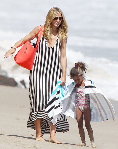 Heidi Klum hit the beach in Malibu looking easy and breezy in a striped maxi BCBG Max Azria dress and a bright red tote bag.