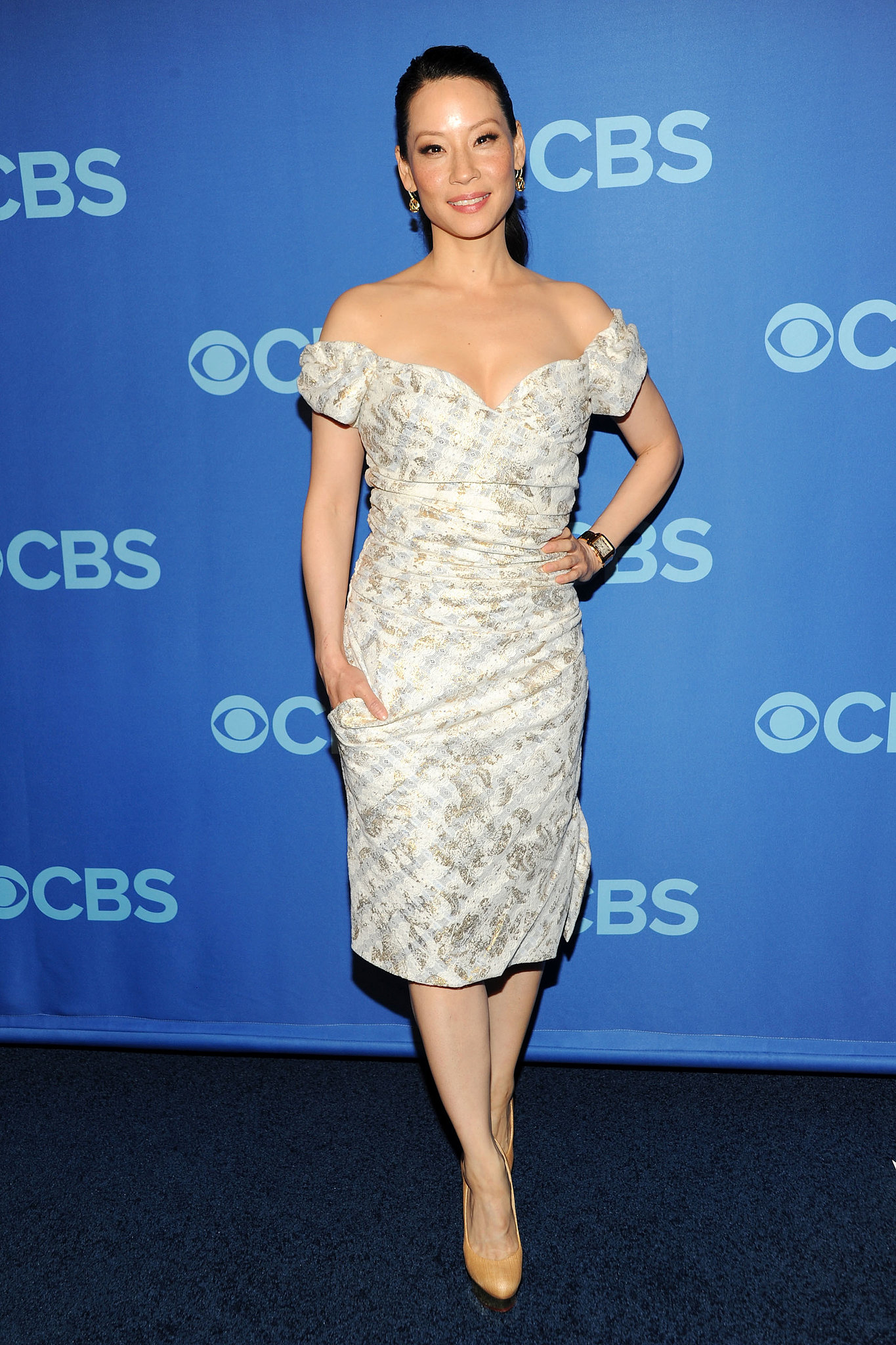 Lucy Liu put her décolletage on display in an off-the-shoulder printed dress at the CBS upfronts in NYC.