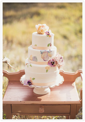 Pastel colors automatically make a cake feel girlie; top that with hand-painted details, and you've got one charming dessert.  Photo by Alixann Loosle Photography via 100 Layer Cake