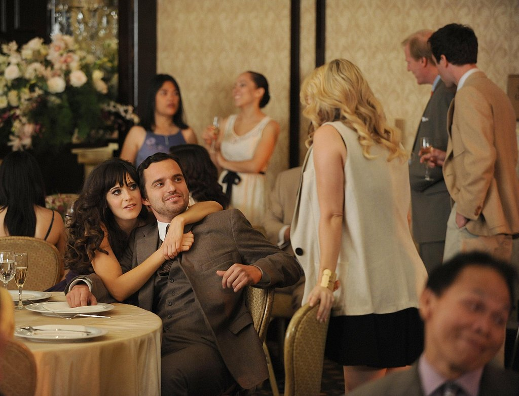 As Nick's wedding date, Jess gets playfully defensive, giving him a squeeze in front of his ex-girlfriend.