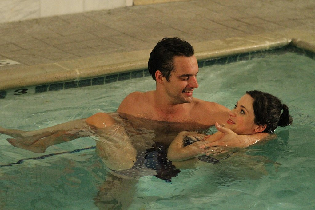 "Nick shows Jess the art of ""water therapy,"" and she looks pretty happy in his arms."