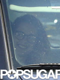 Kristen Stewart smiled in the passenger seat.
