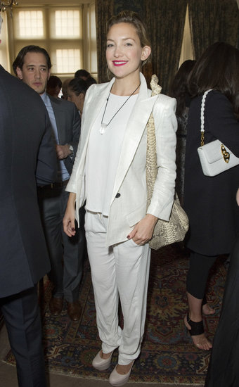 Kate Hudson wore a white metallic pantsuit.