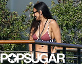 Demi Moore wore a bikini at friend Harry Morton's home.