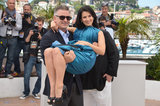 Alec Baldwin swept his pregnant wife, Hilaria, off her feet at his Seduced and Abandoned photocall in Cannes.