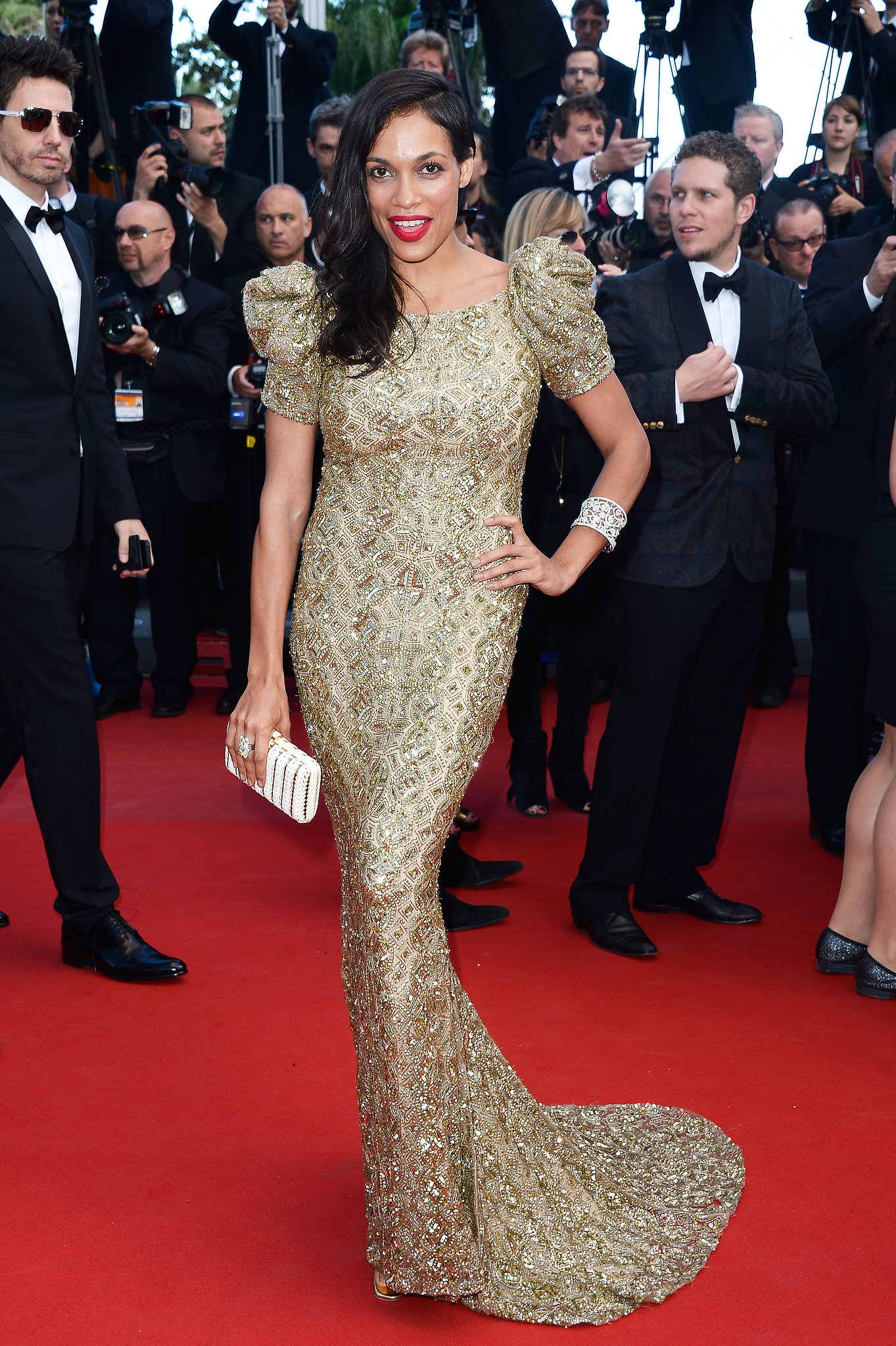 Rosario Dawson lit up the Cleopatra red carpet in a gilded Marchesa gown and bright red lip.