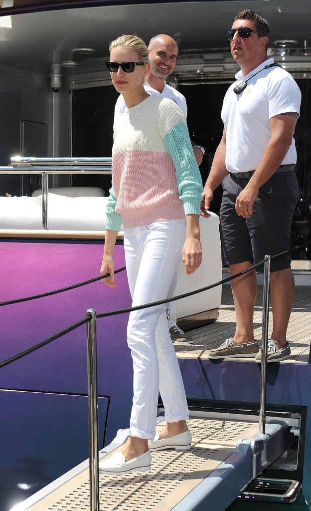 While boarding a yacht in Cannes, Karolina Kurkova gave her white denim a preppy spin with white loafers and a colorblocked sweater.