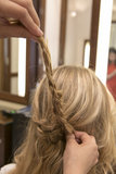 Lay that bend in the braid to the right to create the half-up shape.