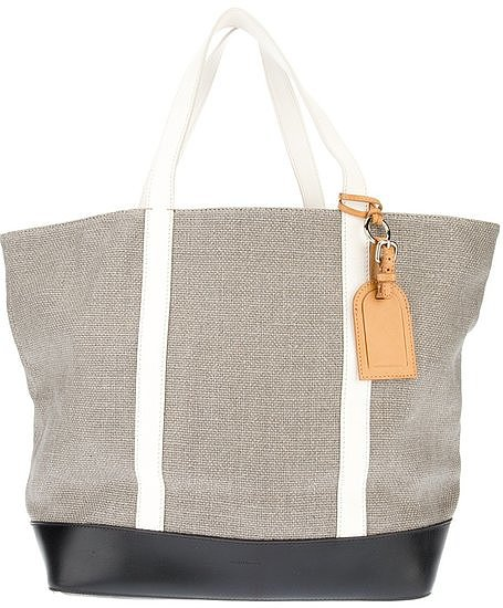 The beach tote you'll use season after season — and not just to the beach, either. We love the neutral hue and classic accent colors on this Vanessa Bruno tote ($362).