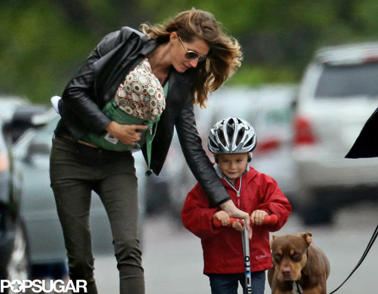 Gisele Bündchen carried Vivian during a ride around Boston with Benjamin.